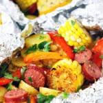 Grilled Cajun Sausage Veggie Foil Dinners.