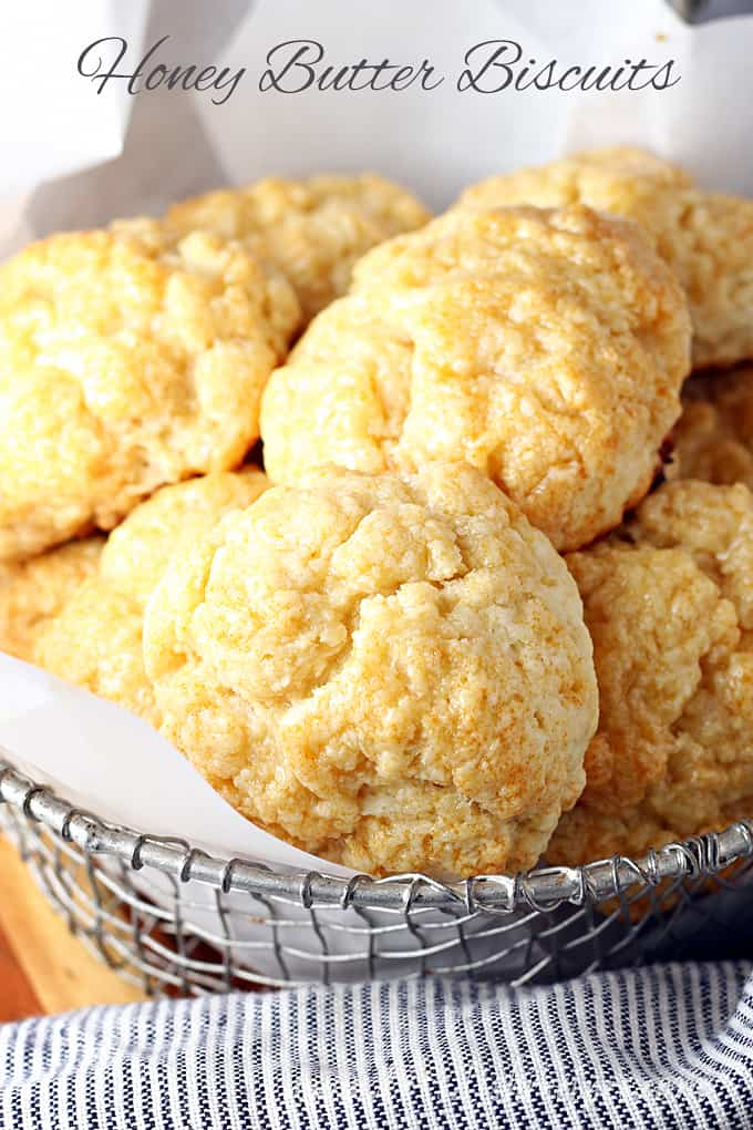 honey butter biscuits in wire mesh bowl